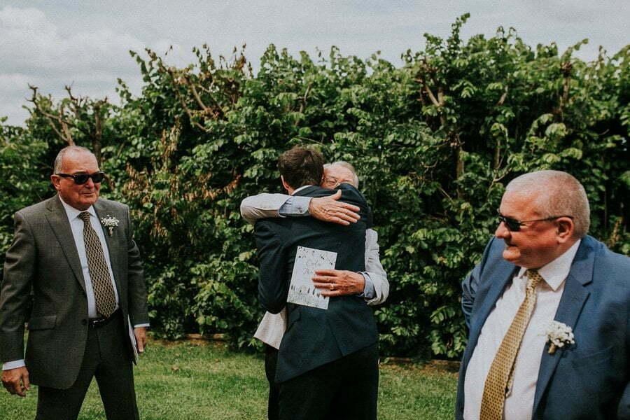 hugs and kisses at wedding