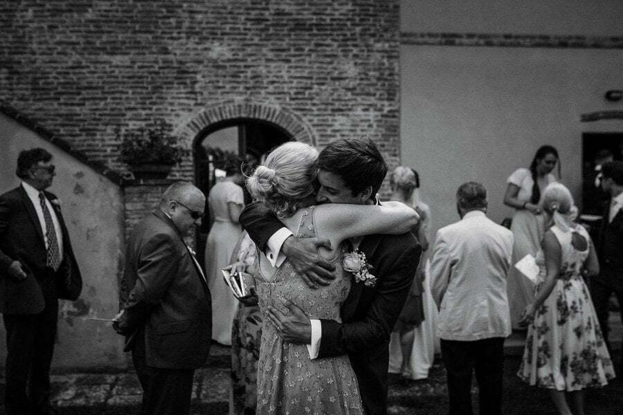 groom and mother in law hug at wedding