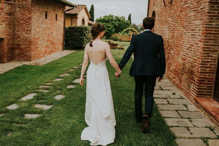 married couple walking in Casale del Marchese