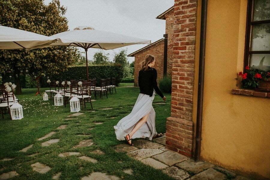 bridesmaid walking away from the rain